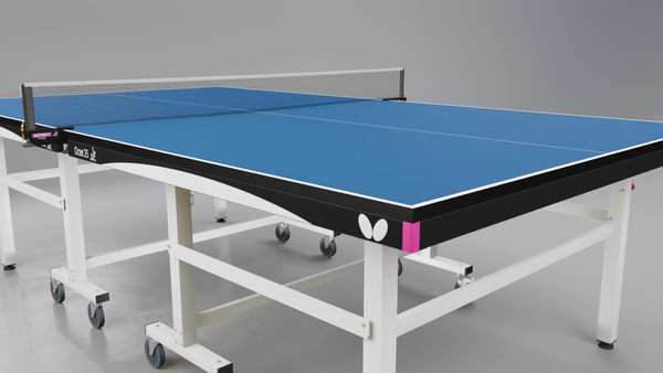 The Butterfly Octet 25 Rollaway Table Tennis Table pictured here in blue, is a professional table tennis table that has pink endcaps and adorned with the white Butterfly wing logo.