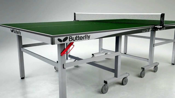 The Butterfly Octet 25 Rollaway Table Tennis Table pictured here in green, is a professional table tennis table that has black endcaps and adorned with the old butterfly logo in black print.