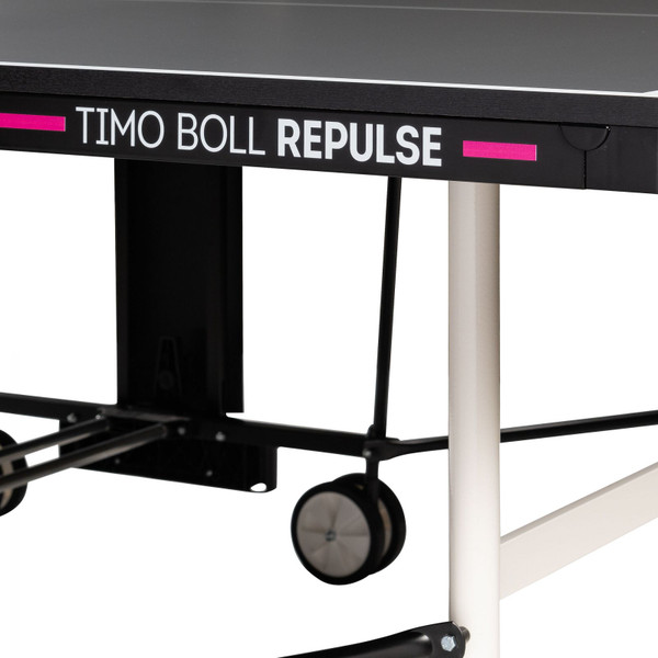 The Butterfly Timo Boll Repulse Indoor Ping Pong Table is shown here with the tables name printed on the side, with a medium pink line.
